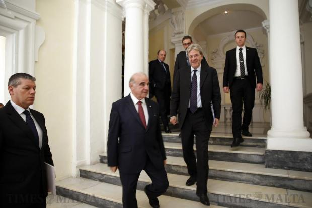 Malta's Foreign Minister George Vella (2nd left) and his Italian counterpart Paolo Gentiloni (3rd left) arrive for a joint news conference at the Foreign Ministry in Valletta on March 10. Photo: Darrin Zammit Lupi