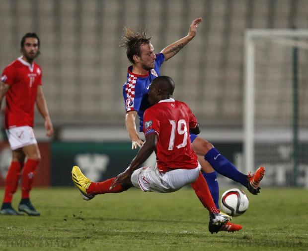 Croatia's Ivan Rakitic (top) and Malta's Alfred Effiong clash during their Euro 2016 Group H qualification soccer match at the National Stadium in Ta' Qali on October 13. Photo: Darrin Zammit Lupi