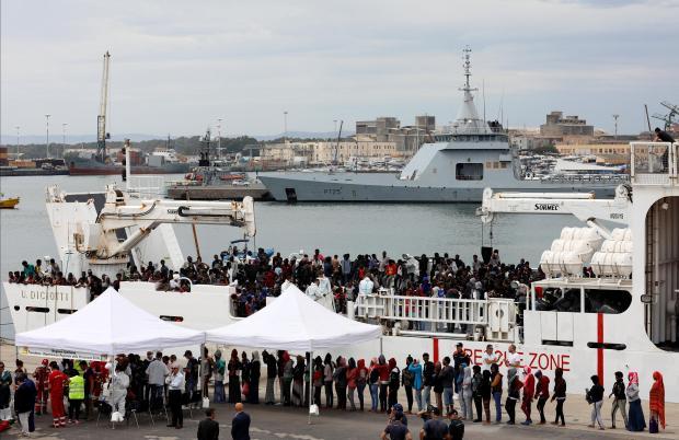 """Migrants disembark Italian coast guard vessel """"Diciotti"""" at Catania last month. File photo: Reuters"""
