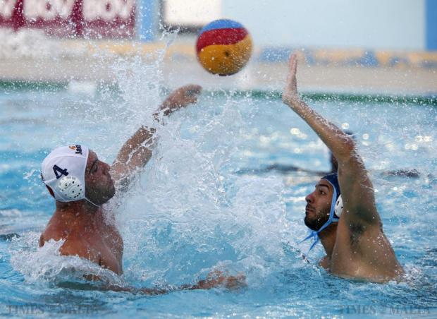 Sliema's Jerome Gabarretta (right) attempts to block a shot on goal by Neptunes's Michele Stellini (left) during their waterpolo National League match at the National Pool in Tal-Qroqq on July 12. Photo: Darrin Zammit Lupi