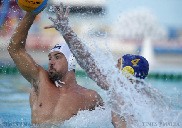 San Giljan's Boris Vapenski (right) tries to block Neptunes' Steven Camilleri during their National League waterpolo match at the National Pool in Tal-Qroqq on June 6. Photo: Darrin Zammit Lupi