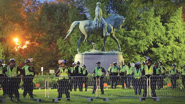 Police were deployed around the statue of civil war Confederate General Robert E. Lee in Charlottesville, Virginia. Photo: Brian Snyder/Reuters
