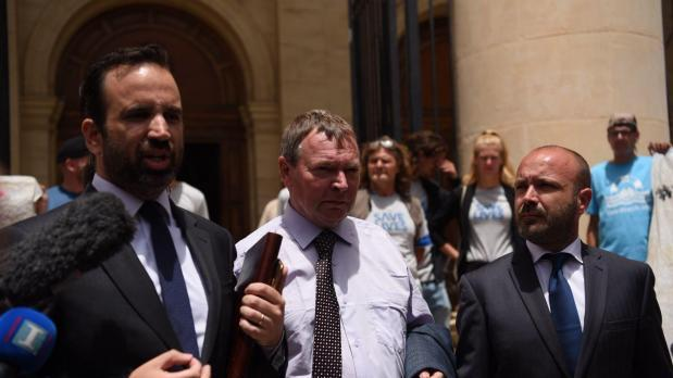 Lifeline captain Claus-Peter Reisch with his lawyers outside the law courts. Photo: Mark Zammit Cordina (file photo)