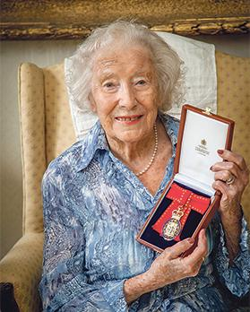 Holding her medal of the Member of the Order of the Companions of Honour at her home in Ditchling, East Sussex. Photo: Lucy Carnaghan Photography/PA Wire