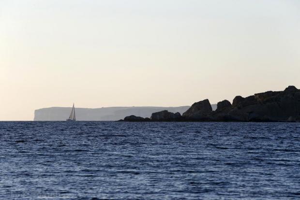A yacht sails off Ghajn Tuffieha Bay on the north-west coast of Malta on April 10. Photo: Darrin Zammit Lupi