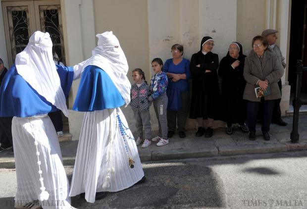 Masked people form part of the pilgrimage involving a walk between St Clement Chapel and the church of St Gregory in Zejtun on April 8. Photo: Chris Sant Fournier