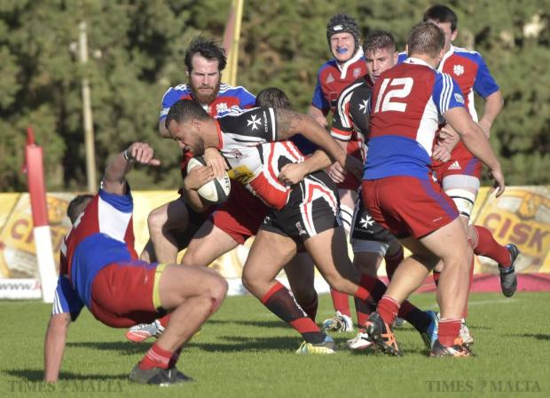 A Maltese player tries to get through the Czech rearguard during the Division 2A match held at Hibs Stadium on November 22. Malta lost 13-20. Photo: Mark Zammit Cordina.