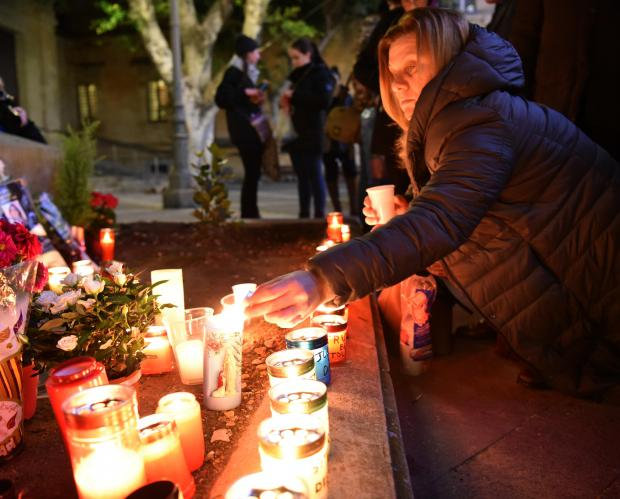 A Woman Lights up Candles in Valletta during a Vigil three months after Journalist Daphne Caruana Galizia was Murdered on January 16. Photo: Mark Zammit Cordina