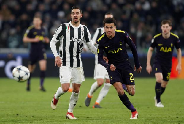 Dele Alli (right) eyes the ball ahead of Matteo De Sciglio, of Juventus.