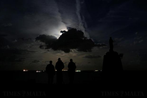 People wait for the supermoon to emerge from behind a cloud at l-Ahrax tal-Mellieha on November 14. Photo: Darrin Zammit Lupi