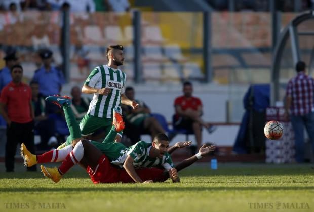 Floriana's Jurgen Pisani falls flat on Valletta's Romeu Romao during their Premier League football match at the National Stadium in Ta' Qali on October 18. Photo: Darrin Zammit Lupi