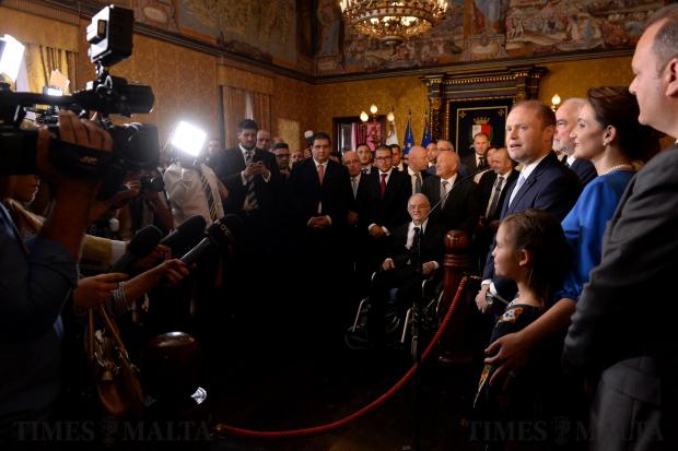 Joseph Muscat accompanied by his wife, Michelle Muscat and two daughters, speak to members of the press after being sworn in as Prime Minister at the Palace of the Grand Master, Valletta on June 05. Photo: Matthew Mirabelli