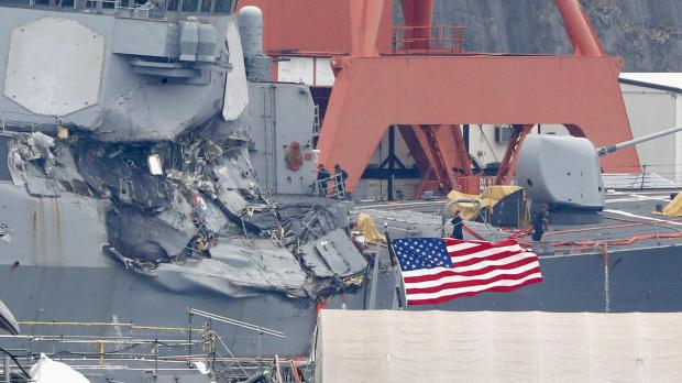 The Arleigh Burke-class guided-missile destroyer USS Fitzgerald, damaged by colliding with a Philippine-flagged merchant vessel, is seen at the US naval base in Yokosuka. photo: Kyodo via Reuters