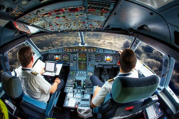 The attention demands of the cockpit can lead pilots to ignore risk warnings from other members of the crew. Skycolors/Shutterstock