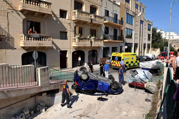 A driver, 26, and his passenger, 34, both of Naxxar, were injured when the car they were in overturned in Mannarino Road, Birkirkara, on August 10. The car was travelling towards Birkirkara when the driver lost control by the VAT offices. It smashed through railings and traffic signs and rolled on to a road about two metres below. A parked car was damaged. Photo: Chris Sant Fournier