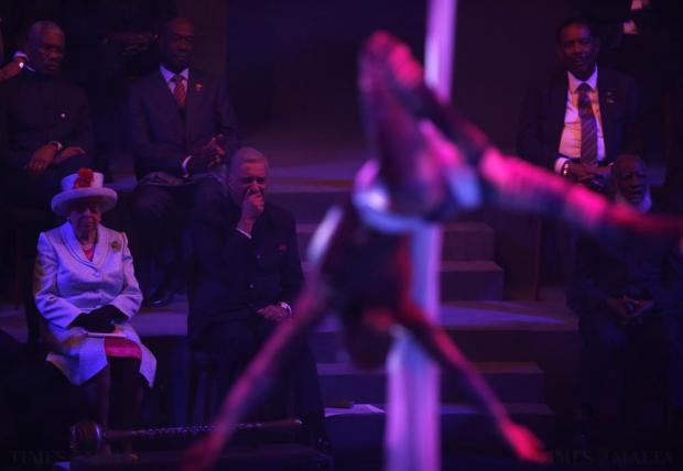 Britain's Queen Elizabeth and Commonwealth Secretary-General Kamalesh Sharma watch artists perform during the opening ceremony of the Commonwealth Heads of Government Meeting (CHOGM) in Valletta on November 27. Photo: Darrin Zammit Lupi