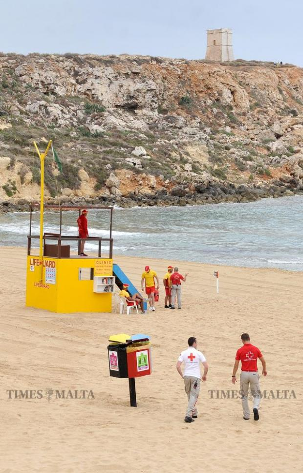 Lifeguards walk along the beach at Golden Bay on June 1. Golden Bay has, for the first time, been awarded the coveted blue flag status bringing the total of Blue Flag beaches in Malta to ten. Photo: Chris Sant Fournier