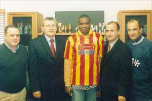 Rufin Oba, wearing the Stripes` colours, poses for a picture with club chairman Victor Zammit (second from left), coach Stephen Azzopardi (second from right) and officials Charles Micallef (left) and John Borg.