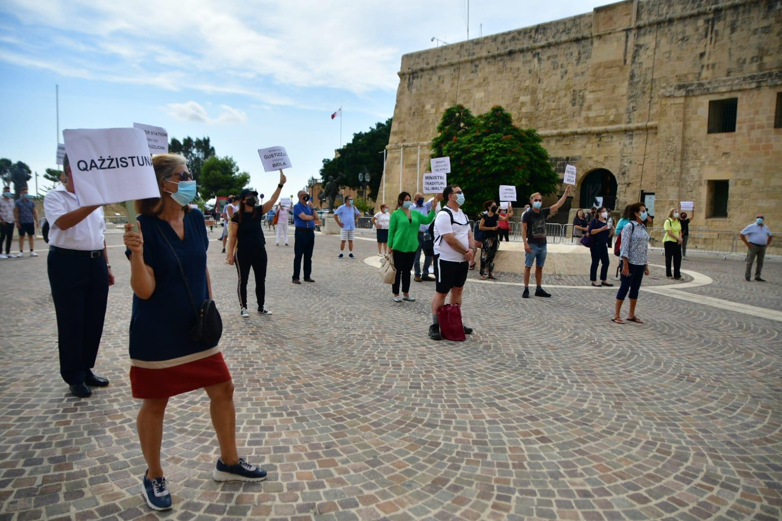 Protesters held a socially distanced demonstration in front of Castille. Photo: Jonathan Borg