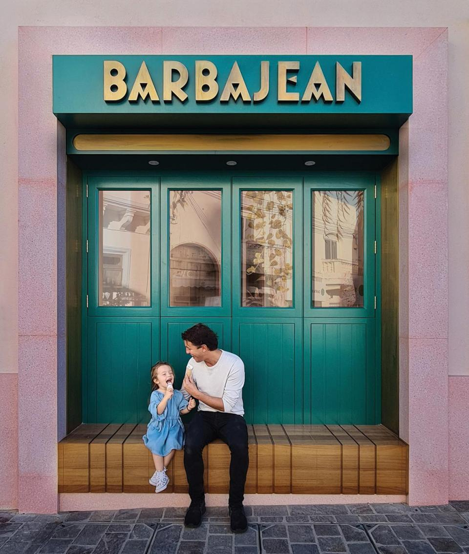 Designer Jonathan Mizzi enjoying an ice cream with his daughter outside the eatery.