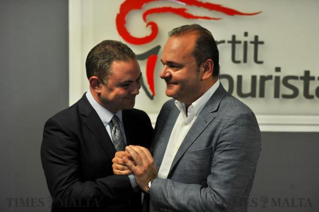 Owen Bonnici congratulates newly elected Labour Party deputy leader Chris Cardona at the Labour Headquarters in Hamrun during the final showdown for deputy leader on June 11. Photo: Steve Zammit Lupi