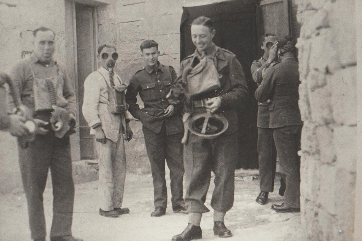Men of the 2nd Battalion King's Own Malta Regiment trying out their Mk 3 lightweight gas masks.