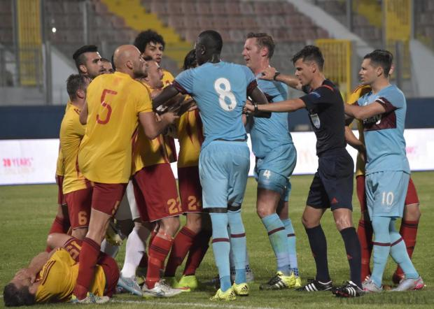 Tempers flare after West Ham's James Tomkins pushed Birkirkara's Nikolai Vukanac to the ground during their UEFA Europa League qualifier at the National Stadium in Ta'Qali on 23 July. Photo: Mark Zammit Cordina