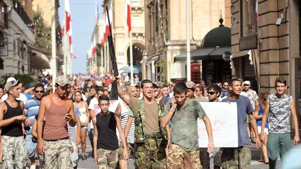 Hunters take to Valletta's streets in the form of a spontaneous protest against the government's decision to ban all hunting till October 10 after several reports of hunting illegalities. Photo: Chris Sant Fournier