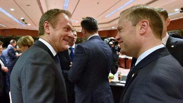 Prime Minister Joseph Muscat chats with EU Council president Donald Tusk before the summit started.