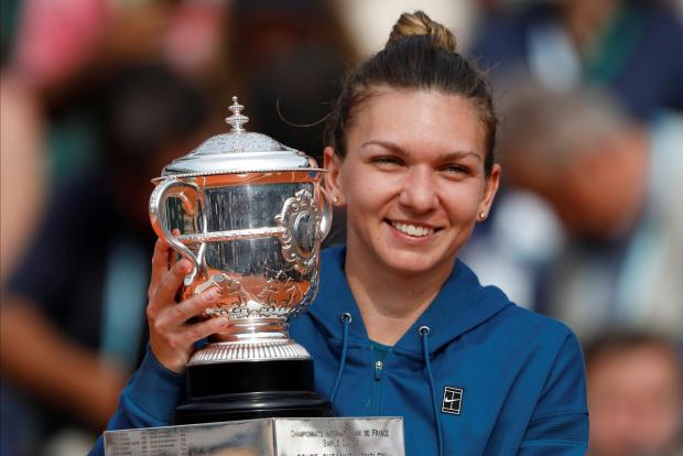 Simona Halep holds the trophy after defeating Sloane Stephens in the French Open final.
