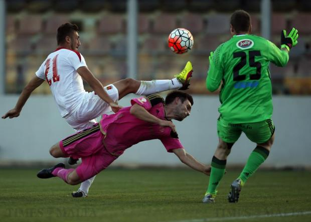 Valletta's Llywelyn Cremona and B36 Torshavn's Jonas Por Naes clash for the ball as B36 goalkeeper Trygvi Ashkam moves in during the first leg of their Champions League first qualifying round football match at the Hibs Stadium in Corradino on June 28. Photo: Darrin Zammit Lupi