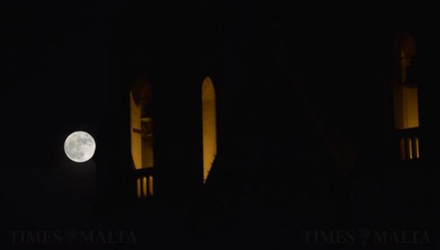 The supermoon rises behind the Balluta church bell tower in St Julian's on November 14. Photo: Mark Zammit Cordina