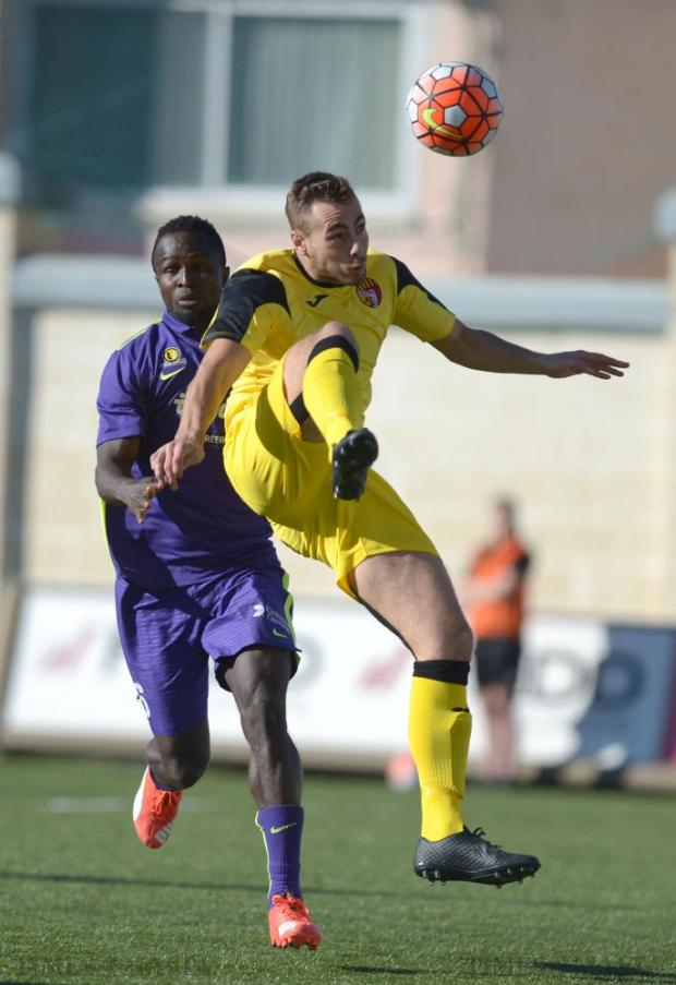 Qormi's Djamel Leeflang (right) and St Andrew's Edafe Uzeh compete for the ball during their Premier League match at Tedesco Stadium in Hamrun on December 12. Photo: Matthew Mirabelli
