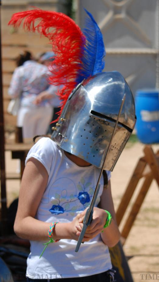 A young girl wears a helmet and holds a sword at the Jousting festival at Fort Rinella in Kalkara on 24 May. Photo: Mark Zammit Cordina