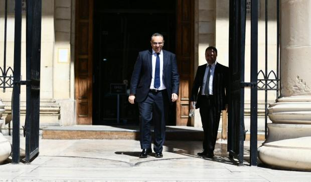 File photo of Keith Schembri walking out of court.