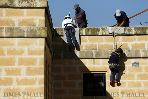 Children abseil from the top of a building during the annual international Christmas fair at San Andrea School in Mgarr on December 11. Photo: Darrin Zammit Lupi