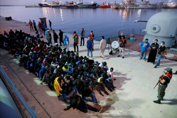 Migrants arrive at a naval base after they were rescued (?) by Libyan Navy, in Tripoli, November 4, 2017. Photo: Reuters/Ahmed Jadallah