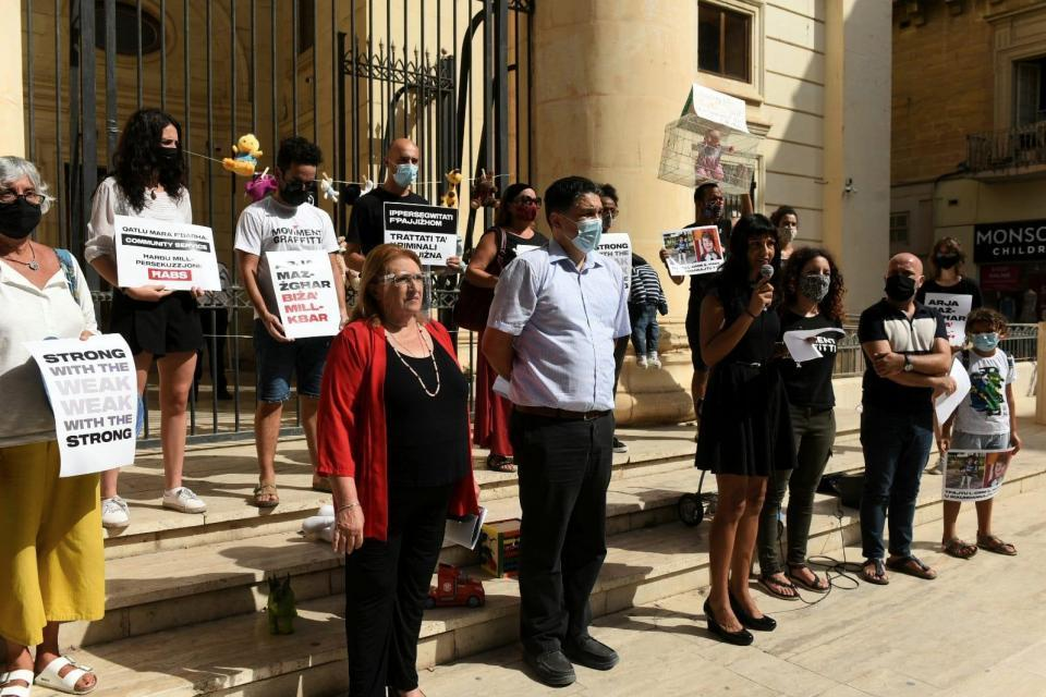 President emeritus Marie-Louise Coleiro Preca was among those who gathered for a protest outside the court on Thursday.