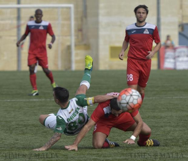 Floriana's Nicholas Chiesa is tackled by Pembroke defender Owen Bugeja during their Premier League football match at the Tedesco Stadium in Hamrun on November 20. Photo: Mark Zammit Cordina