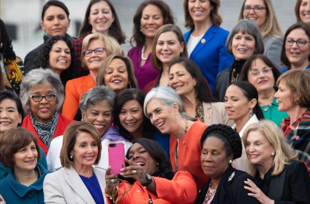 "Speaker of the House Nancy Pelosi (C L) takes a ""selfie"" with US Representative Terri Sewell (C R) as they stand with female House Democratic members of the 116th Congress for a photo."