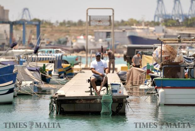 A man fishes in Marsaxlokk on June 1. Photo: Chris Sant Fournier