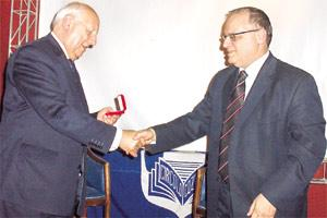 Dr Grazio Mercieca, chairman of he Circolo Gozitano, presenting the award to Mr Speaker, Anton Tabone
