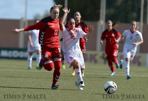 Malta's Emma Xuereb (right) tries to make her way past Lithuania's Vestina Neverdauskaite during their friendly match at the Centenary Stadium in Ta'Qali on February 10. Photo: Matthew Mirabelli