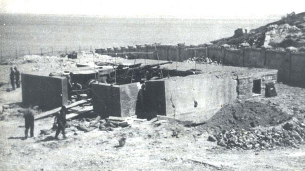 A Heavy Anti-Aircraft position at Tigné. The crater close by is made by a bomb that just missed the emplacement.