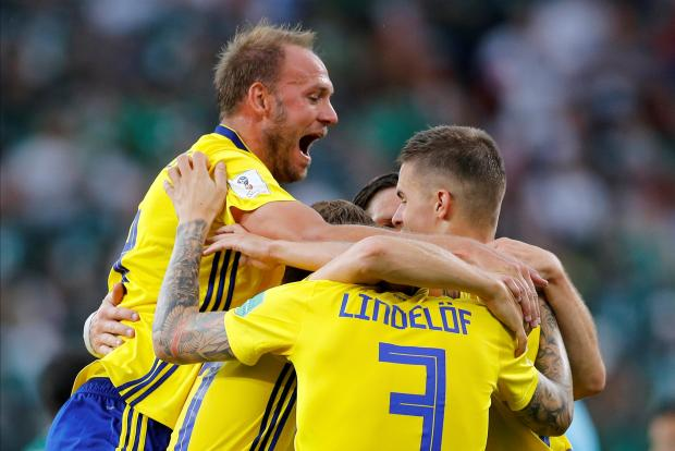 Sweden's Andreas Granqvist celebrates after the match with team mates.