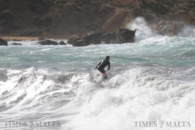 A surfer enjoys the waves at Ghajn Tuffieha Bay on January 7. Photo: Matthew Mirabelli