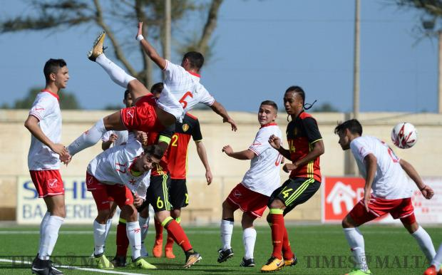 Players compete for the ball during Malta's match against Belgium in theUEFA U17 Championship at the Centenary Stadium in Ta'Qali on October 26. Photo: Matthew Mirabelli