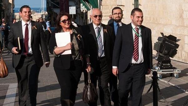 Civil Rights Minister Helena Dalli enters parliament, wearing the gay movement's colours on her lapel. (Picture Vince Piscopo)