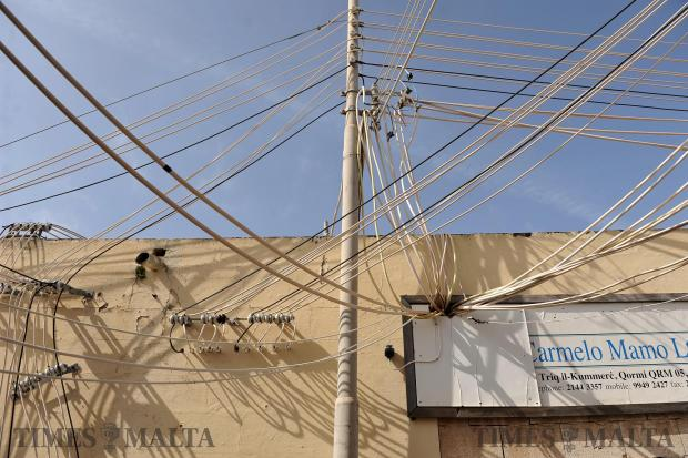 Wires cling to a pole at the old Trade Fair in Naxxar on April 26. Photo: Chris Sant Fournier