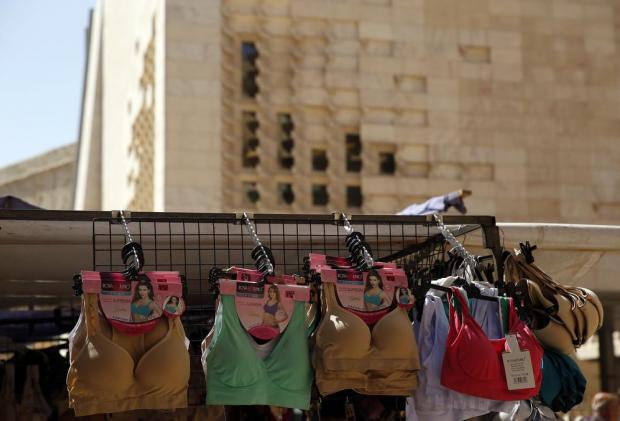 Underwear and bargain clothing at the Valletta flea market, better known as the Monti, are seen against the backdrop of Renzo Piano's landmark Parliament building in Valletta on August 1. Photo: Darrin Zammit Lupi